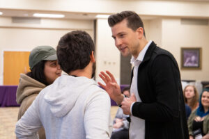 Tom talking with student